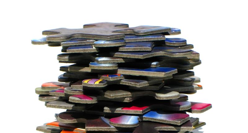 Stack of puzzle pieces, Image source: Sanja Gjenero, Freeimages.com