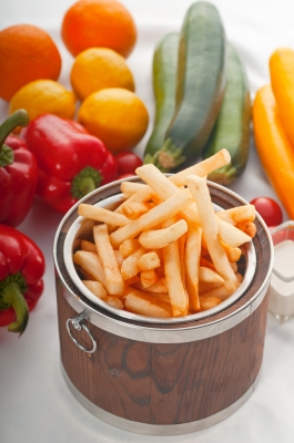 Fancy French fries on a plate with vegetables. Image source: KEK064, Freedigitalphotos.net
