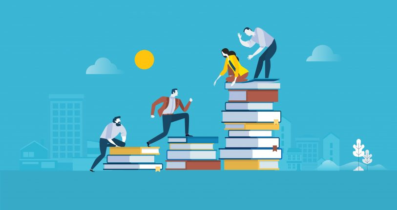 What new skills have you learned during the pandemic. Image of people helping each óther up onto stacks of books.